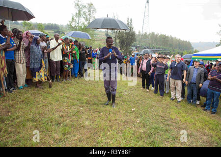 (181124) -- KAMONYI (RWANDA), Nov. 24, 2018 (Xinhua) -- Rwandan Foreign Minister Richard Sezibera (C) speaks during monthly community work, Umuganda, in Kamonyi district, central Rwanda, on Nov. 24, 2018. Diplomatic missions in Rwanda and Rwandan Ministry of Foreign Affairs and International Cooperation on Saturday organized a diplomatic Umuganda in Kamonyi. Taking root from Rwandan culture of self-help and cooperation, Umuganda, held on the last Saturday of the month, can be translated as 'coming together in common purpose to achieve an outcome,' according to Rwanda Governance Board. (Xinhua/