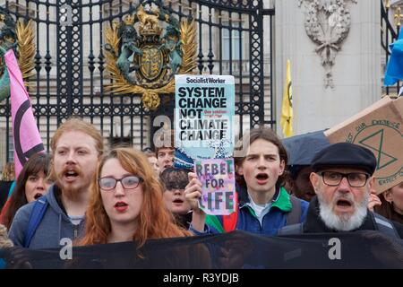 Saturday November 24 2018. Climate change campaign group Extinction Rebellion deliver a protest against climate change at the gates of Buckingham Palace - London, UK, - Stock Photo