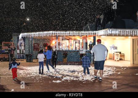 Los Angeles, California, USA. 23rd  November, 2018. Attendees enjoy the artificial snow at the inaugural 'Winterfest' Holiday event held at Santa Anita Park in Arcadia, California on November 23, 2018.  Credit: Sheri Determan/Alamy Live News - Stock Photo