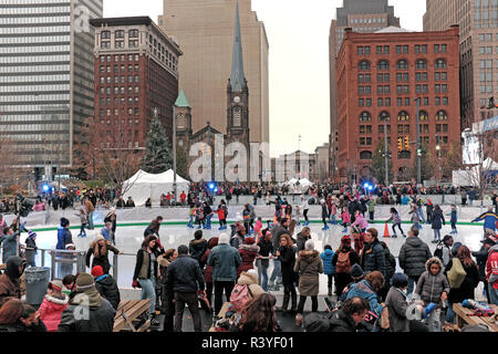 Cleveland, Ohio, USA.  24th Nov, 2018.  Thousands attend the 36th Annual Winterfest in Public Square in downtown Cleveland, Ohio, USA.  The seasonal ice rink opened amidst the holiday festival activities going on all around it.  Credit: Mark Kanning/Alamy Live News. - Stock Photo