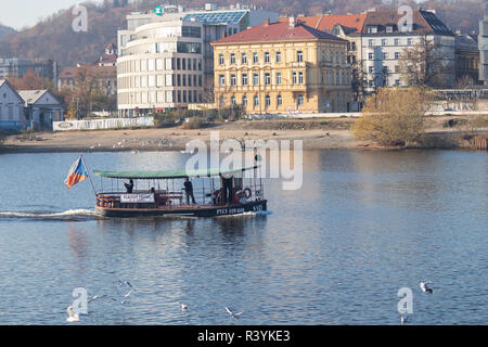 PRAGUE, CZECH REPUBLIC - NOVEMBER 17, 2018: Ferry boat on the Vltava river - Stock Photo