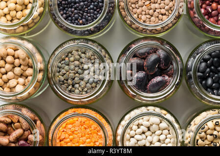various dried legumes in jars - Stock Photo