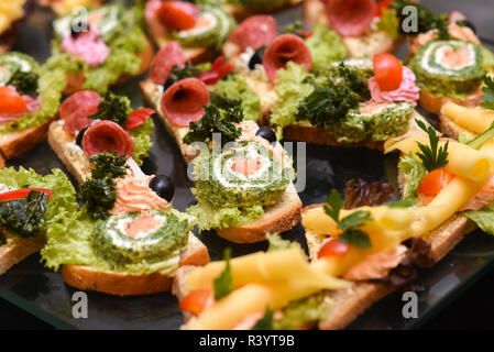 A lot of sandwiches on the epergne, sandwich buffet. - Stock Photo