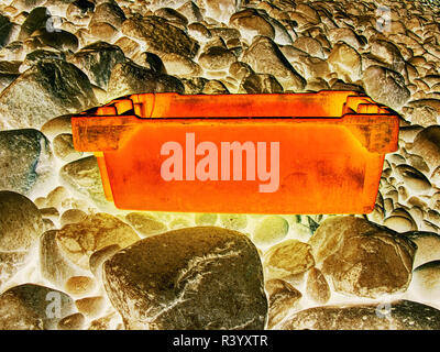 Dangerous garbage ejected from the sea on remote beaches. Environmental contamination with toxic mess..  Hipster filter. - Stock Photo