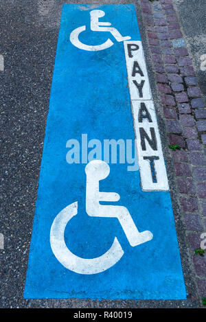 Signs on asphalt, Parking for people with disabilities, Alsace, France - Stock Photo