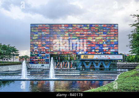 Hilversum, The Netherlands, August 25, 2018: South facade of Beeld en Geluid, the Dutch Institute for Sound and Vision, with colorful historic tv scen - Stock Photo