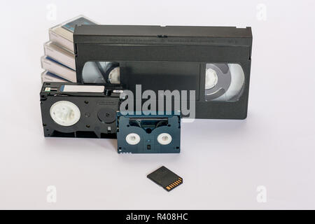 Mini dv and  VHS video tape isolated on white.  SD and MicroSD cards. Cassettes. - Stock Photo