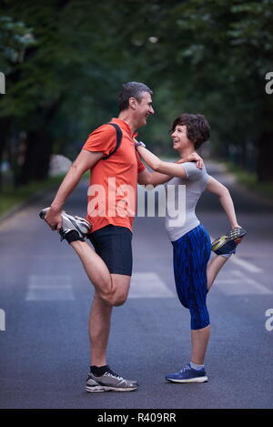 jogging couple stretching - Stock Photo
