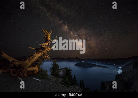 The Milky Way over Wizard Island at Crater Lake National Park, Oregon, USA - Stock Photo