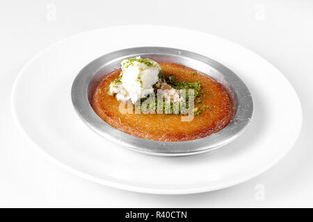 Delicious Traditional Turkish Dessert Kunefe with Pistachio Powder - Stock Photo