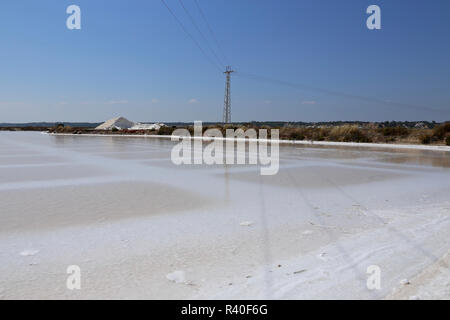 Isla Cristina, Spain: sea salt production, the salt evaporation pond near the border of Portugal - Stock Photo