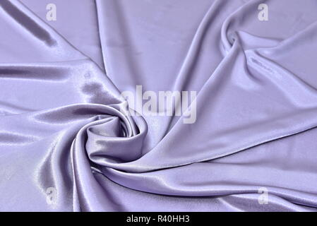 Beautiful smooth elegant wavy violet purple satin silk luxury cloth fabric texture, abstract background design. Card or banner. sewing material abstra - Stock Photo