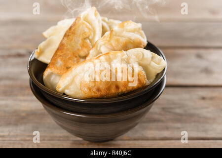 Popular Chinese food pan fried dumplings - Stock Photo