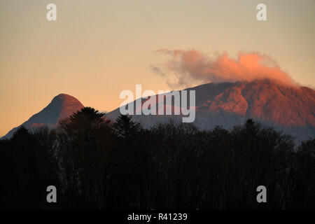 The Pap of Glencoe taken from Invercoe in the Scotland, Scottish Highlands during sunset glow. - Stock Photo