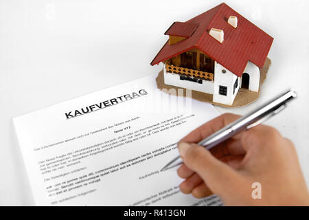 Signing real estate contract - Concept with the German Word Kaufvertrag