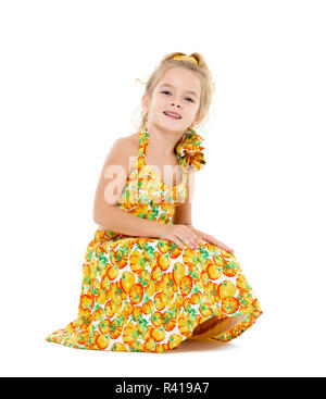 Little Girl in a Yellow Dress Posing - Stock Photo