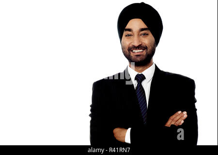 Confident smiling Indian businessman - Stock Photo
