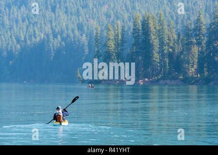 USA, Washington State. Kayaker on Baker Lake. Anderson Point Campground. (MR) - Stock Photo