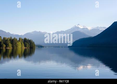 USA, Washington State. Mt. Shuksan reflected in morning light on calm Baker Lake - Stock Photo