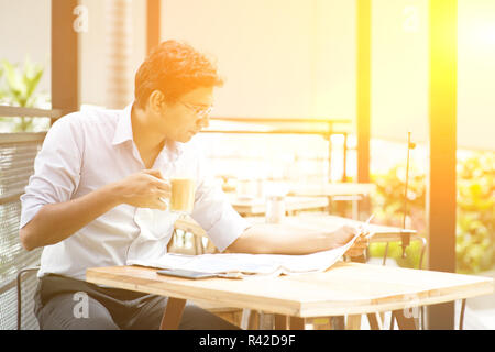 Indian business man relaxing - Stock Photo