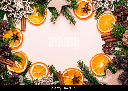 Christmas natural frame of Dry Oranges Slices, fir cones and branches. - Stock Photo