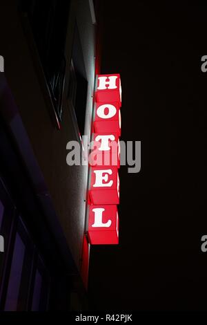 neon sign of a hotel in downtown cologne - Stock Photo