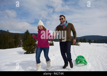 happy young couple having fun on fresh show on winter vacation - Stock Photo