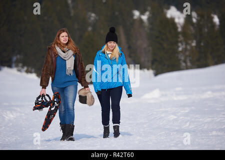 female friends in beautiful winter day have relaxed walk on snow - Stock Photo