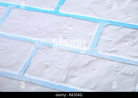 Diy  Homemade background under the white brick of plywood, putty and