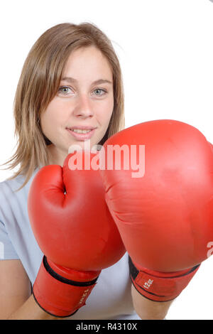 beautiful young woman wearing a pair of boxing gloves - Stock Photo