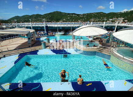 The pool deck on Royal Caribbean's Adventure of the Seas cruise ship. - Stock Photo