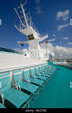 The crow's nest and satellite equipment on the upper deck of Royal Caribbean Interational's Majesty of the Seas cruise ship. - Stock Photo