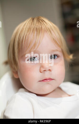 baby face looking seriously - Stock Photo