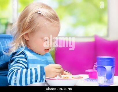 Little baby having breakfast - Stock Photo