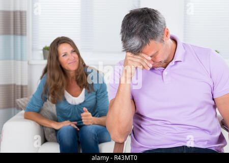 Woman Shouting To The Depressed Man - Stock Photo