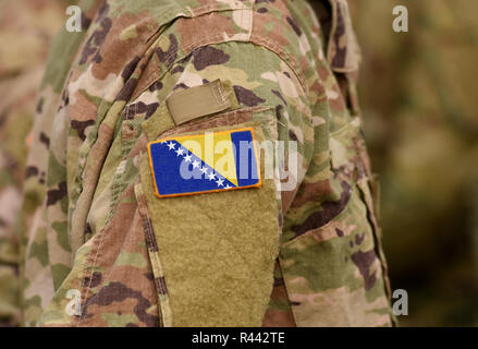 Bosnia and Herzegovina flag on soldiers arm (collage). - Stock Photo