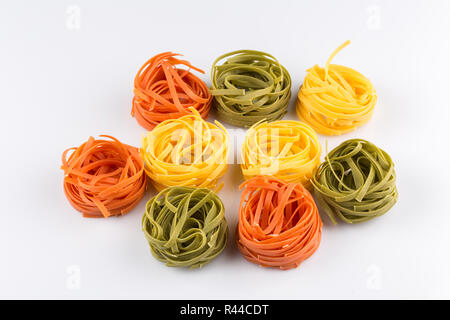 different pasta in three colors - Stock Photo