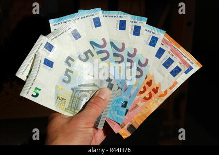 Euro banknotes, hand holds money drawers, cut out, Germany, Europe - Stock Photo