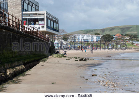View along the sea wall towards The Mowlem Centre and Shore Road at Swanage, Dorset, England, UK - Stock Photo