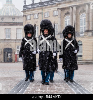 Royal Life Guards in front of Amalienborg Palace during a snow storm, Copenhagen, Denmark - Stock Photo