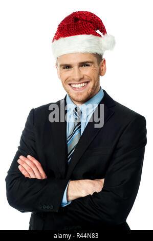 Handsome businessman wearing santa cap - Stock Photo
