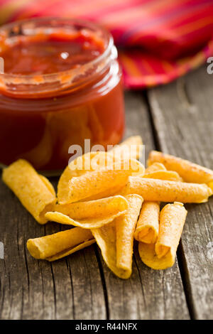 rolled nacho chips and salsa dip - Stock Photo