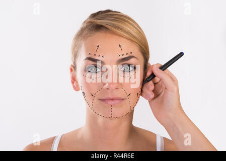 Young Woman Undergoing Facelift Surgery - Stock Photo