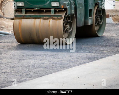 Road Construction Site In Berlin, Germany: Steamroller At Asphalt Pavement Works - Stock Photo