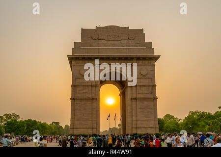 The India Gate and the setting sun - Stock Photo