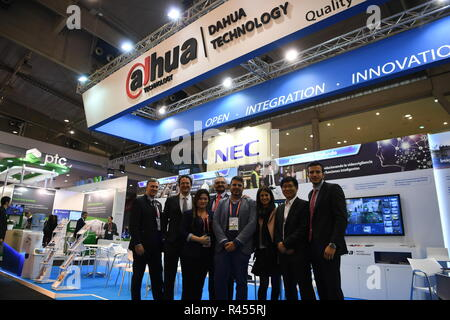 Madrid, Spain, 25 November 2018. Staff members of Zhejiang Dahua Technology Co. Ltd. pose for a group photo during the Smart City Expo World Congress in Barcelona, Spain, on Nov. 15, 2017. More and more Spanish consumers accept Chinese high-tech brands, which now can be seen in daily life across Spain.(Xinhua/Guo Qiuda) Credit: Xinhua/Alamy Live News - Stock Photo