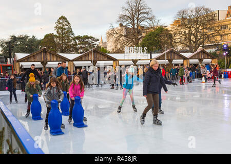 Bournemouth, Dorset, UK. 25th Nov 2018. Visitors enjoy skating on the outdoor ice skate rink in Bournemouth Lower Gardens at Bournemouth in November. outdoors ice skating rink. - Stock Photo
