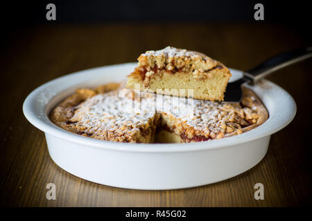 sweet cake with jam in ceramic form - Stock Photo