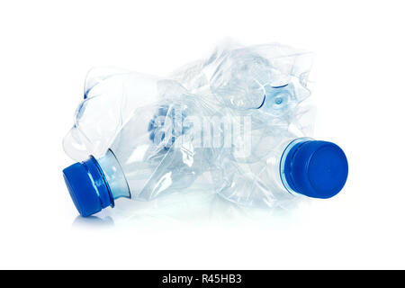 Environmental pollution concept - crumpled plastic bottles isolated on a white background in close-up - Stock Photo