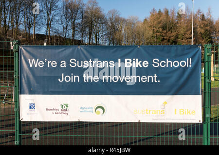 Notice or sign We're a Sustrans I Bike School, in Langholm, Dumfries and Galloway, Scotland, UK - Stock Photo